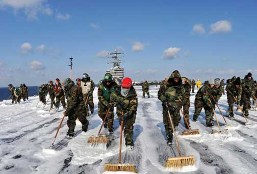 "Sailors aboard the USS Ronald Reagan scrubbed the external surfaces of the flight deck and island superstructure to remove potential radiation contamination on March 23, 2011, while at sea off the coast of Japan, where the aircraft carrier was providing humanitarian assistance as directed in support of Operation Tomodachi, which means ""Friend"" in Japanese. Image by Nicholas Groesch, U. S. Navy."
